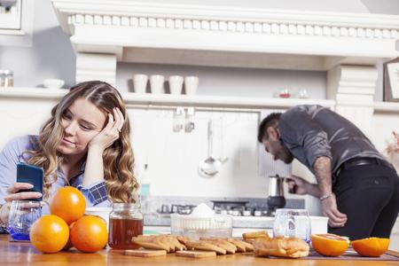 beautiful husband prepares breakfast for a bored wife