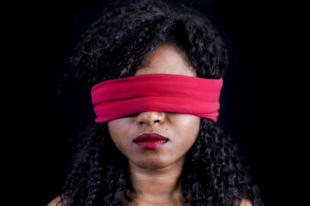 slave girl: portrait of young african american female with a red blindfold on