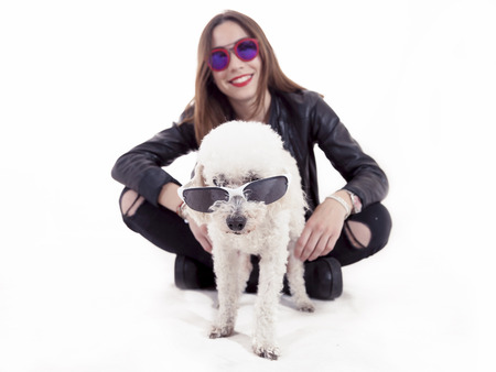man's best friend: portrait of little dog with sunglasses and her young mistress