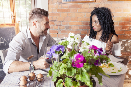 couple dining: romantic young couple dining at a nice restaurant