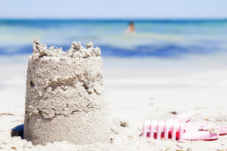 small sand castle on the seashore during summer Stock Photo