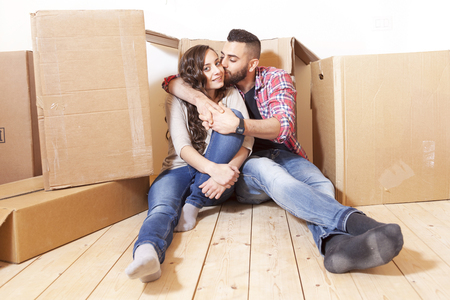 young couple relaxes and kisses after the move Stock Photo