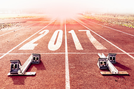 new year 2017 warm look numbers painted on a racing lane Stock Photo