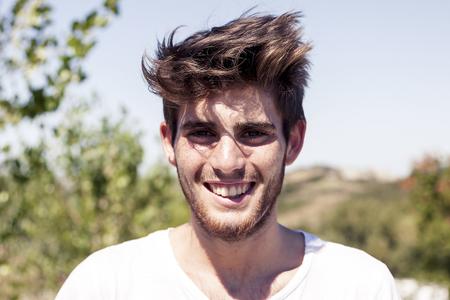sweatshirt: portrait of handsome young adult outdoor on vacation