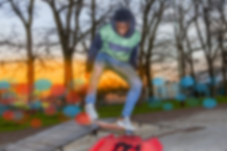 skateboarder: young skateboarder jumping on a ramp outdoor