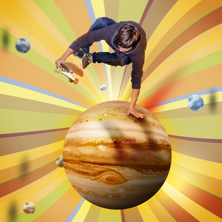 young skateboarder jumping over the jupiter planet aerial view Stock Photo