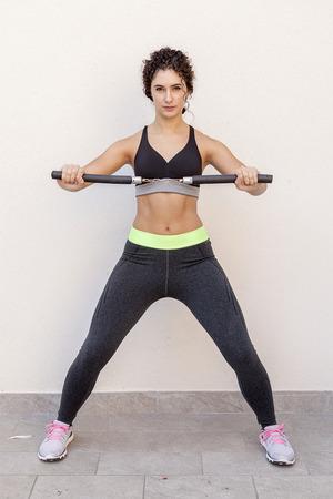 sporty woman training with the nunchaku japanese weapon