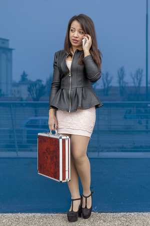 business woman talking on mobile smart phone outside