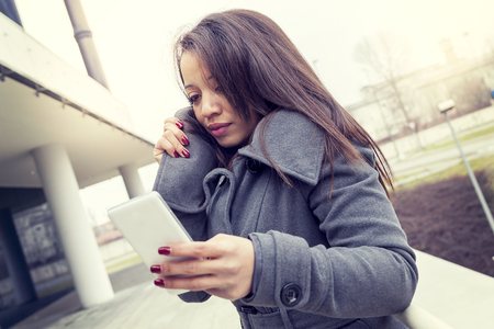 business woman chatting on mobile smart phone outside