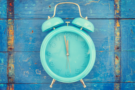 second floor: homemade turquoise alarm clock on blue wooden background