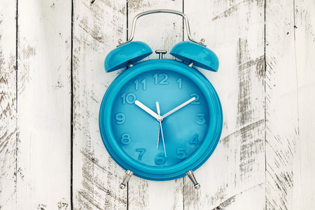 second floor: homemade turquoise alarm clock on white wooden background