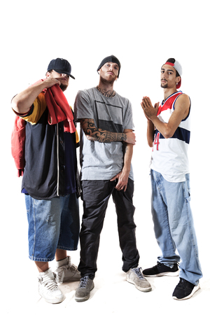 group of three rappers posing in the photographic studio on white background