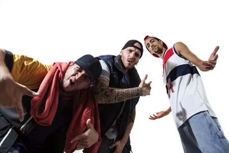 raperos: group of three rappers posing in the photographic studio on white background