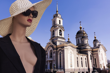portrait of tourist female mannequin in front of Donetsk church cityscape with camera. concept people travelin 写真素材