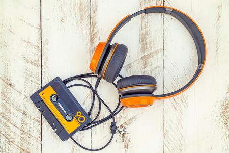 vintage audio cassettes and headphones over a black chalkboard.  retro styled background 版權商用圖片