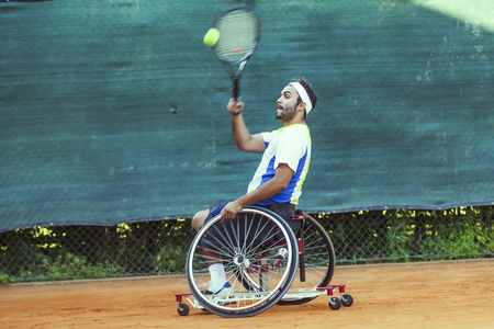 disabled tennis player hits the ball forehand during a match outdoor Stockfoto