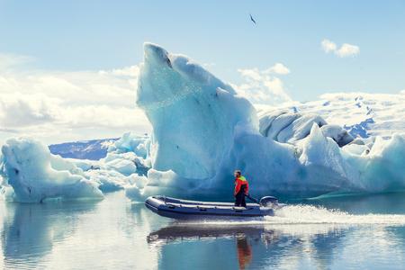 motor boat sailing on the azure waters between the jokulsarlon icebergs