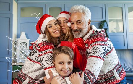 happy family reunited on christmas day hugging each other at home Stok Fotoğraf