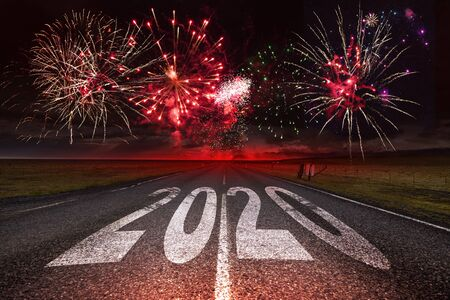 2020 New Year celebration with fireworks on the road asphalt.  New Year arrival concept