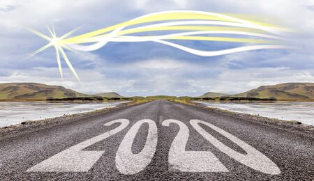2020 New Year celebration on the asphalt road with a modern comet star on a blue sky as a background. New Year arrival concept Imagens