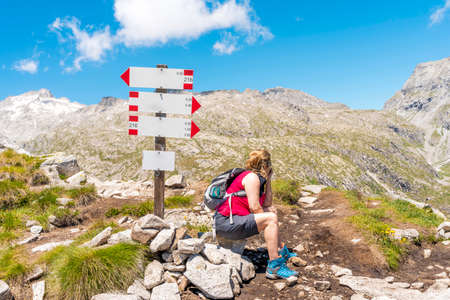 female tourist is taking a break in the high mountains during a trekking in the dolomites Reklamní fotografie
