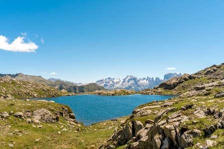 panoramic view of a beautiful lake surrounded by the dolomites mountain range in summertime