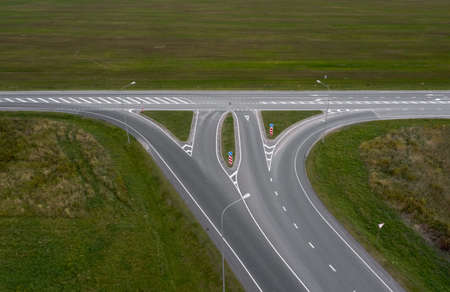 Aerial view of an intersection in the countryside without cars. 写真素材
