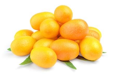 Pile of delicious and juicy kumquat fruit on a white background. Stock Photo