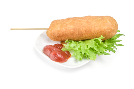 Corn dog with mustard isolated on white background cutout.