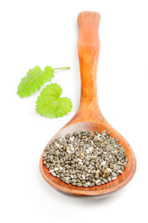 Organic dry chia seeds isolated over a white background