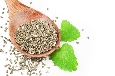 Healthy chia seeds on a white background clipping path Stock Photo