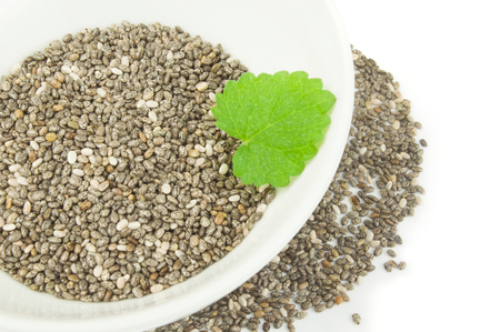 Superfood chia seeds on a white background clipping path Stock Photo
