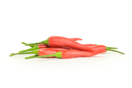 red peppers: Fiery red peppers isolated on a white background with clipping path