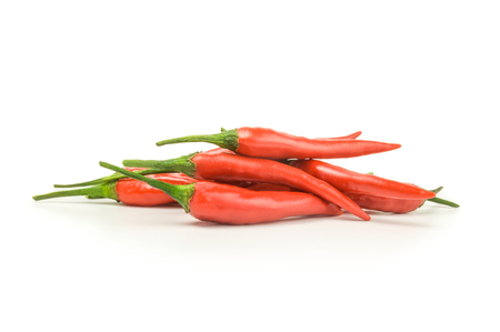 red peppers: Fiery red peppers isolated on a white background cutout