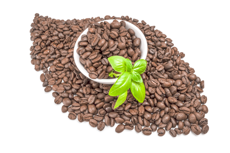Pile of roasted coffee beans isolated on a white background cutout