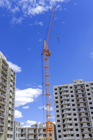 buildingsite: Large crane and building of new apartments