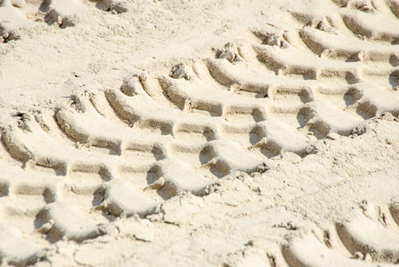 traction: Tread pattern of a truck tire in soft sand. Stock Photo