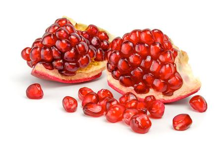 Ripe pomegranate fruit isolated on white background cutout.
