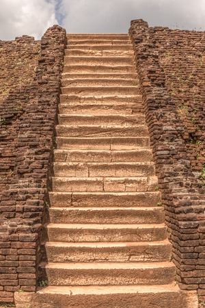 briks: A long ancient stairs from briks and stones leading up.