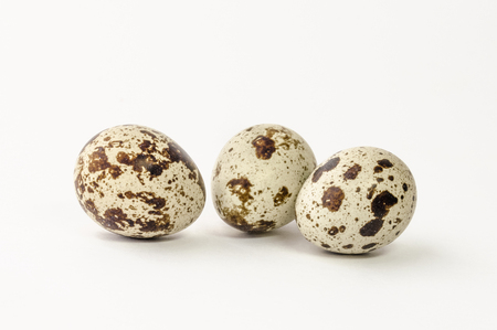Food: group of quail eggs isolated on a white cutout Standard-Bild