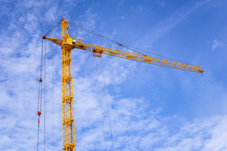 The site with cranes against blue sky. Stock Photo