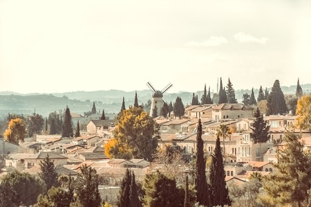jewish houses: View over historical district Yemin Moshe from the Old City of Jerusalem, Israel. Stock Photo