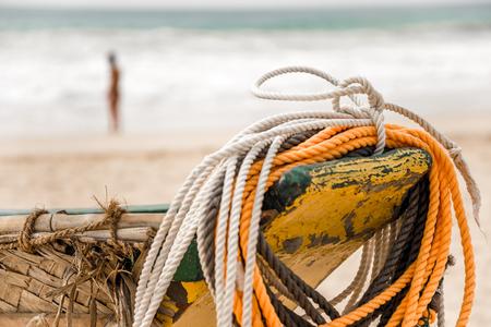 Traditional Sri Lankan fishing boat on sandy beach