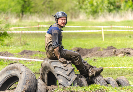 SALOVKA, RUSSIA - MAY 5, 2017: Four-wheel dirve crosses the mud obstacle on the distance of racing
