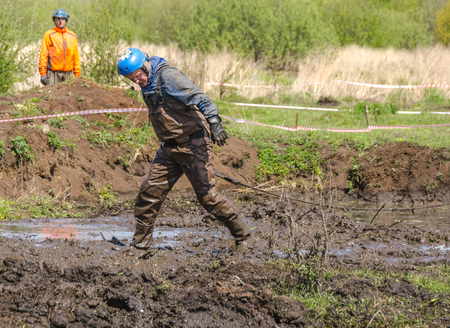 SALOVKA, RUSSIA - MAY 5, 2017: A jeep drives through a deep mud bog but ends up getting stuck.