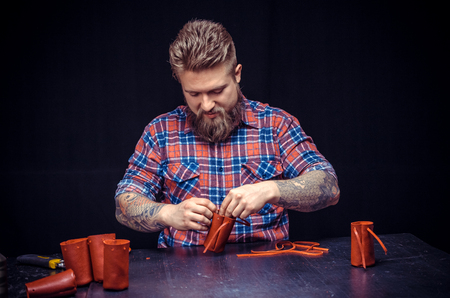 Leather workman creates quality product of leather in his shop