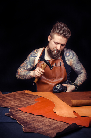 Portrait of shoemaker hammering on a shoe Stock Photo