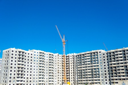 High crane and new multi-storey building Stock Photo