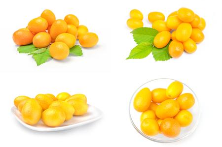 Group of cumquats on white