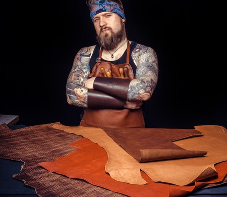Leather workman works with leather goods